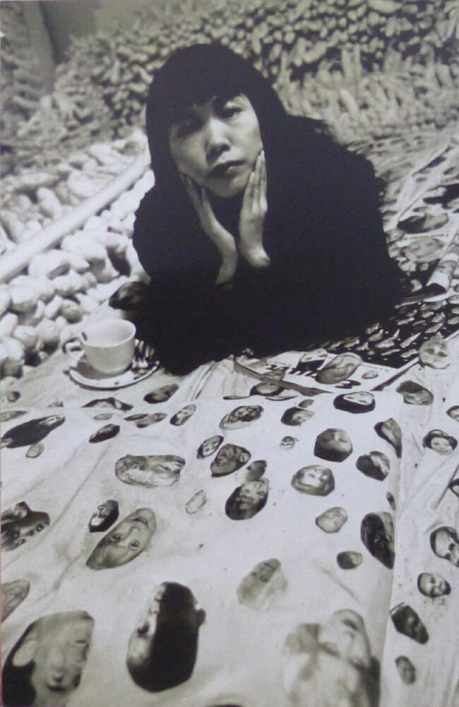 7Yayoi Kusama, with her work, Face Obsession, 1964.jpg